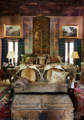 """With Scottish blood on his father's side and a proud history of Scottish culture in the Highlands area, Cook decided to recreate the look of an old Scottish manor for his master bedroom. """"It's my favorite room,"""" Cook says. """"I love its comfort and luxury."""""""