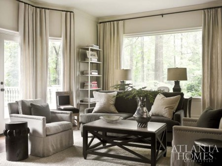 """""""The study almost looks like a black-and-white photo, it's so monochromatic,"""" says Webb. Comfort and durability are key for the sofa and chairs, which are available at Bungalow Classic. Simple panel draperies from Restoration Hardware and pillows from Scott Antique Markets soften the room."""
