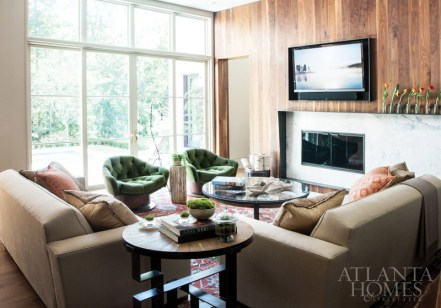 Belding enlisted metalsmith Charles Calhoun to custom design a fireplace surround in the family room. A slab of stone is encased in a unique steel frame that widens as it nears the wall of windows. Wide walnut planking by Skylar Morgan softens the space and adds warmth to the walls. Turn-around swivel club chairs, Coup d'etat through R Hughes. Sultanabad Persian, Sullivan Fine Rugs. Roman Ring floor lamp, Alison Berger Glassworks through Holly Hunt Lighting at Jerry Pair. Aspen firewood bucket, Tuell and Reynolds through R Hughes. Petrified wood, Chip & Co. through R Hughes. Onyx bowls through Jerry Pair.