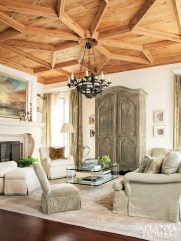 With its almost cathedral-like ceiling, the living room had to offer beautiful—and comfortable—furniture to match. The Edward Ferrell + Lewis Mittman sofa is covered with Zimmer + Rhode fabric, both available through Ainsworth-Noah & Associates. Lucite-and-glass coffee table, Smith Grubbs & Associates. Sultanabad rug, Moattar, Ltd.