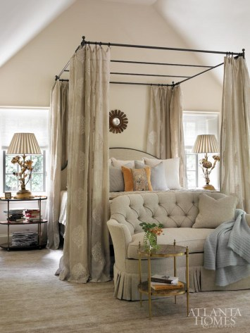 """""""The layout of the bedroom was Bill Litchfield's brilliant thought,"""" says Kay. """"He did an architectural treatment to the wall to make it wider, and turned the molding of the windows to create more space."""" Now, a king-size canopy bed from Mrs. Howard, dressed in panels of Randolph fabric, can rest here comfortably. Bed linens, Susan Shepherd Interiors. Antique pillow, Ainsworth-Noah & Associates. Linen-and-jute rug, Eve & Staron."""