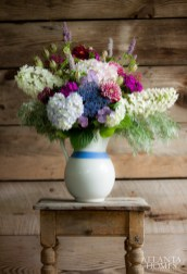 Using an antique ironstone pitcher as his vessel, Robinson created a composition that incorporates Oakleaf, Snowflake and Lacecap hydrangea, along with dahlia, nigella, hissop and artemisia.