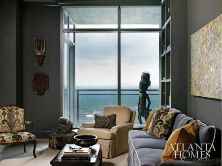 Ebonized cabinetry by Morgan Creek Cabinet Co. and dark upholstery, from plush velvet to corduroy, give the study a tucked away feel with a glimpse of the city below.