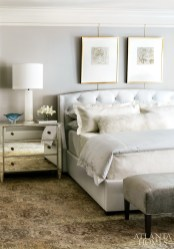 The custom mirrored chests in the master were fabricated by a North Carolina artisan; the alabaster lamps are from The Mercantile. Tufted leather bed, Bungalow Classic. Bedding, Gramercy Home. Framed works on paper, Huff Harrington Fine Art. Armoire, Noir.