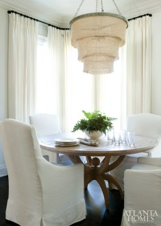 Breakfast table, Global Views. Chairs, Restoration Hardware. Coco bead chandelier, Made Goods.