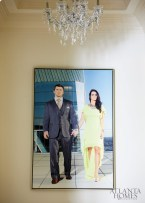 A portrait of the couple hangs in the bedroom entrance.