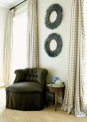 """A simple seating area in the master bedroom. Curtain fabric, Rogers & Goffigon Ltd. Slipper chair, O""""Henry, Travis and Co. Chair fabric, Rogers & Goffigon Ltd. Side table, Antiques and Beyond, (404) 872-4342. Industrial pieces, South of Market, (404) 995-9399."""