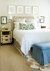 Giles says she uses a neutral backdrop in most of her interiors, and her own master bedroom is no different. Headboard, dust skirt and drapery fabrics, Rogers & Goffigon Ltd. Crewel pillow, Nancy Corzine, Ainsworth-Noah. Side table, Donghia, ADAC, (404) 842-0760. Lamp, Boyd, Jerry Pair. Art in black frames, Galerie Timothy Tew, (404) 869-0511. Vintage fashion drawings and pony rug, Pieces, (404) 869-2476.