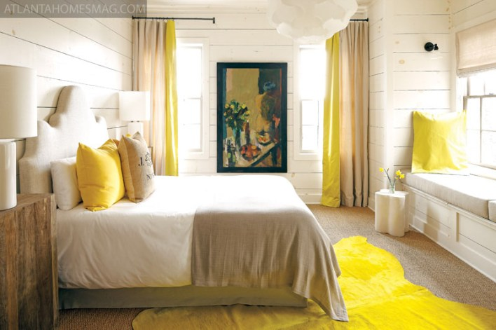 "With pops of sunshine yellow and views of the lake, this bedroom""s cheery disposition makes it a favorite of overnight guests. Painting by Cynthia Packard."