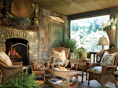 The fireside conversation grouping on the screened porch is joined by a child's chair in front of the fireplace because, says Frank, every room needs a touch of whimsy. The screened porch allows Frank to take advantage of the cool mountain climate. The wicker furniture is by Mainly Baskets.
