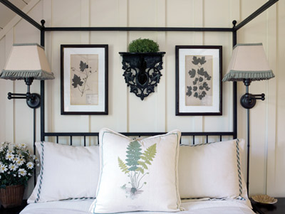 The botanical theme of this bedroom is right in step with the natural beauty outdoors. Although the framed art appears to be pressed plants, they're actually very fine prints. The pillow's fern design is hand-painted silk by Bob Garner.