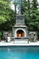 A stacked Cherokee stone fireplace creates a new focal point in the refashioned backyard.