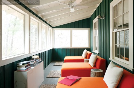 When the house formerly served as a lodge in the early 20th century, the sleeping porch contained rows of bunk beds. The space now dons chic orange chaises from CB2.