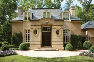 1998: Harrison creates Norman-inspired development at 675 West Paces Ferry. Firm also designs first show house in conjunction with Neiman Marcus and Southern Accents.