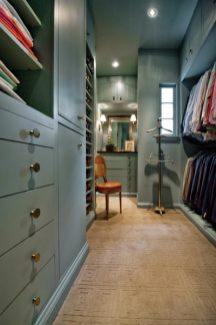 The two master closets feature a Donald Kaufman paint color that was inspired by the color of the pantry at the Swan House.