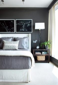 In the guest room, a headboard with nailhead trim provides just the right amount of cocooning, while also framing a sumptuous mix of bedding by Dea and Signoria and a scroll-patterned accent pillow from South of Market.