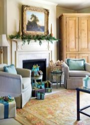 """One of Carol Moore""""s treasured paintings hangs over the mantel. """"Fishing by the Pond,"""" James Francis Williams, 1785-1846. Chairs upholstered in Summer Hill Ltd.""""s """"Cabana Stripe"""" in chocolate. Fabric available through Ainsworth-Noah, ADAC, (404) 239-8462. Finials on mantel, Historic Roswell Antique Market, (770) 587-5259."""