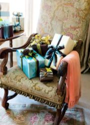 """A room doesn""""t have to scream """"Christmas"""" to embrace the holiday spirit. Here, a few thoughtfully wrapped gifts by ribbon impresario Nicholas Kniel await opening."""