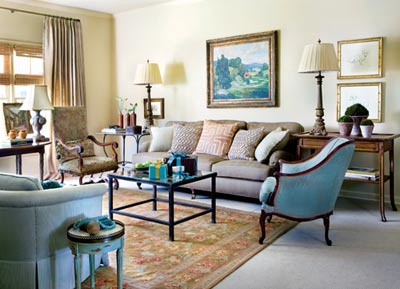 """A Chinese needlepoint rug atop wall-to-wall sisal anchors the living room. Sofa, Acquisitions, (404) 261-2478. Rug, Stark Carpet, ADAC, (404) 266-8959. Sisal, Archer Hannah, (770) 643-2099. Antique bergere covered in Brunschwig & Fils """"Soleil Damask."""" French metal side table and velvet cutwork pillows, Erika Reade Ltd., (404) 233-3857. Art Nouveau oak side table and iron coffee table, Provenance Antiques, (404) 351-1217. Pair of gilt lamps, Interiors Market, (404) 352-0055."""