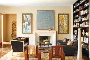 In the living room, a painting by Athens artist Richard Olsen hangs above the fireplace. It is flanked by two oil-on-fabric paintings from the 1920s. The 1930s wood colonial veranda chairs are sculptural in their own right.