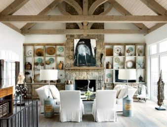 Leaving no detail of this house unattended, Williams hand picked every element from the sculptural beams and pale Swedish stained floors to lavender storage containers-turned-lamps and eye-catching artworks. The painting over the fireplace is underscored by a mantel crafted from a fragment of a ship.