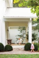 When the couple purchased the home in 1997, the front porch was screened in and cumbersome to access. Elizabeth took out the screen a decade ago, but the couple finally finished the look last year by adding stylish brick steps.