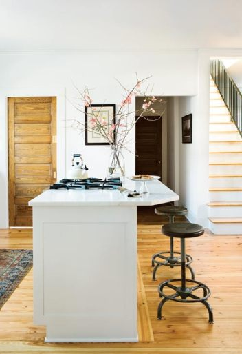 The kitchen was formerly the first room you entered at the back of the house, but now a mudroom, partitioned off by a sliding door, provides the perfect landing for children and pets as well as Andrew, who uses it as a pit stop for removing his work boots.