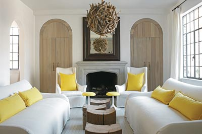 Sunny yellow accents in the living room add punch to the otherwise neutral scheme.