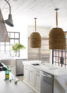 Stainless steel appliances and white surfaces give the kitchen a very clean, modern appearance. The basket-style hanging fixtures are quintessential South of Market. Dishwashers, KitchenAid. Refrigerator/freezer, Sub-Zero. Flooring, Peacock Pavers.