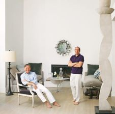 John Oetgen (left) and John Lineweaver's living room includes an original Curtis Jere mirror. The center table is by Francois-Xavier Lalanne. Bronze floor lamp by Robert Kuo. In addition to the sofas, Oetgen also designed the cast sculpture—one of three—for a local charity benefit.