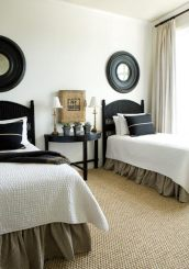 Because the Moores' grandchildren visit frequently, multiple guest rooms are a must. This one, outfitted with twin beds, is stunning thanks in part to its symmetry and simplicity.