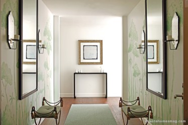"""In the entry, """"I wanted to create a 'gasp of tranquility,' something tranquil but exciting at the same time,"""" Oetgen says. The hand-painted walls—done by the designer himself—impart much of that serenity, the green trees creating a personal oasis."""