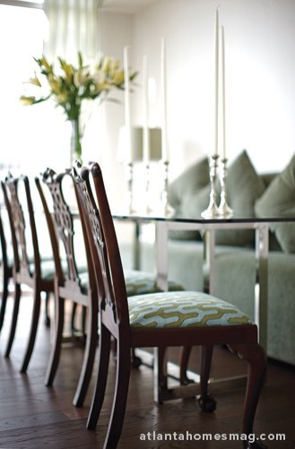Queen Anne chairs provide a snapshot view of this condo's design scheme; the frame and fabric meld old and new while green and blue hues are indicative of the overall color palette.