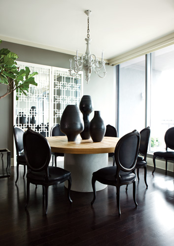 """The screens in the dining area were used as headboards in the Kleinhelters"""" previous home."""