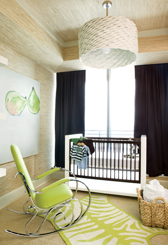 """The green zebra rug in the nursery is a popular item from Lee""""s store available by custom order in an array of colors. The crib is from B. Braithwaite, the rocker is a vintage find and the pear painting is one Lee has had for years."""