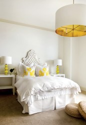 """Touches of sunny yellow give just the right amount of spunk to the bedroom of Lee""""s stepdaughter, Madison. """"The tufted headboard was one I reupholstered and reused from our previous house. I love remaking things, because moving shouldn""""t mean that you are discarding all the time,"""" she says. """"Add a fresh coat of paint, reupholster and try to think of a different way that it can be used."""""""