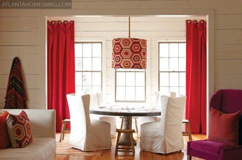 "Connected to three spaces""the living room, kitchen and a balcony that overlooks Lake Rabun""the dining room of Kay Douglass"" vacation house is the veritable heart of the home. The felt curtain fabric is Pollack""s Vilano, available through Donghia. Table, chairs and stools, South of Market."