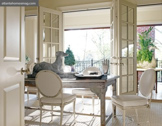 French doors in the upstairs office open onto a terrace. Simply outfitted with a zinc-top table and French iron-frame chairs, it's a relaxing retreat as much as it is a work space. Table, The Gables Antiques.