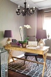 """For the assistant""""s office, which is shared by several Jenner Communications employees, Flynn kept the overall vibe neutral, opting for layered taupes and gray-browns with accents of violet."""