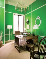 "Although Huff considers his favorite shade of bright green to be ""soothing,"" he admits that the color ""needs to be broken up."" He did so by adding white trim to his office walls, which gives the effect of a paneled room."