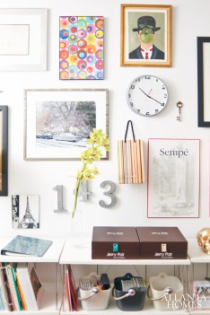 A gallery wall includes a framed sample of his best-selling wrapping paper line.