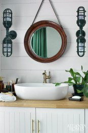 A mix of high and low price points allows you to feel indulgent- without breaking the bank. Sconces from barnlightelectric.com. Leather mirror from Go Home at AmericasMart. Vanity cabinet and countertop from IKEA. Vessel sink from Delta. Vanity hardware from Colonial Bronze Co. through Masterpiece Lighting.