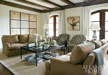Framed antique maps of Paris create a focal point in the inviting family room, blanketed in soft neutrals and pops of celadon through lamps from Parc Monceau.