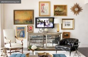 """Though the couple both have a penchant for acquiring artwork and antiques, downsizing from their Mountain Brook home required paring down their collection to a few key pieces. A gallery wall provided an easy solution to showcasing some of their favorites, including a pair of Moorish blackamores""""a gift from Teresa""""s great-uncle Herschel, an interior designer who influenced Teresa""""s work""""and a mirrored chest bought on 1stDibs.com that helps """"build a bridge"""" by bringing old and new together."""
