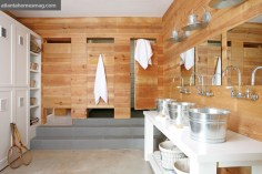 The camp-style bath in the bunk room can accomodate the chaos and cacophony that follows a day spent outdoors hiking, biking, skeet shooting or fly fishing. The touch-latch doors of the two stalls on the right conceal showers, while the stall on the left contains the water closet. Locker room-esque storage was built by Bell Custom Cabinetry. Tile available through Traditions in Tile. Faucets, PDI. Towels, Gramercy Home.