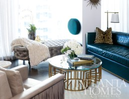 The living room by Michel Boyd is chic and seductive. The Butler Sofa is clad in a sumptuous green leather, and the Janis Club Chair is adorned with a sexy leather fringe. The chairs and the Charlotte Cocktail Table are available through Bradley Hughes. Boyd's design firm, SmithBoyd Interiors, designed the tufted daybed.