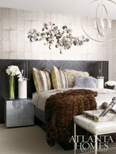In the guest bedroom, the Charlize Maple Bed features a black walnut finish and is flanked by a pair of Constantine Table Lamps, which rest atop mirrored Sophie Side Tables. All of these pieces, plus the Jessica Chandelier and the Hunter Bench at the foot of the bed are available through Bradley Hughes.