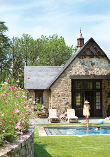 The pool house was designed to be used year-round. During spring and summer, the lush greenery and blooms add even more dimension to the outdoor spaces.