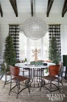 An expert at mixing high and low, Flynn paired Grey Furniture's marble-and- powder-coated steel gear table with Rocket dining chairs from hayneedle.com.