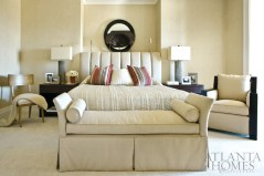 """The neutral palette in the master bedroom and throughout the residence works beautifully, thanks in large part to Topol's philosophy: He doesn't blend colors; he matches exactly. """"Everybody 'plays' with color, but we don't mess with it,"""" he says. """"A neutral room quickly becomes boring if the colors are off."""" Bedroom floral designs by Jackson Durham."""
